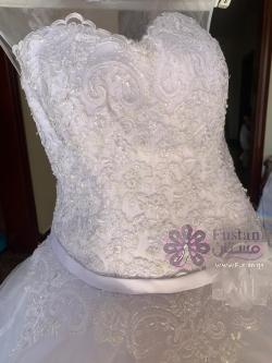 فستان عروس مشكوك